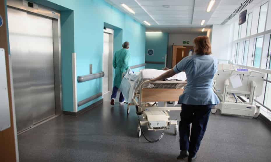 NHS staff take a patient to the operating theatre.