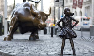 The 'Charging Bull' and 'Fearless Girl' statues on Lower Broadway in New York.