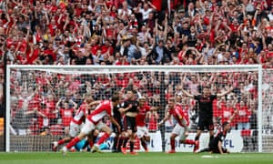 The agony and the ecstasy: Patrick Bauer sends Charlton to the Championship.