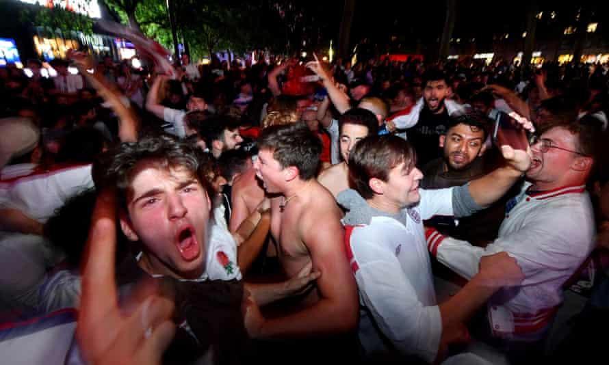 England fans celebrate the win at the Trafalgar Square fan zone in London.