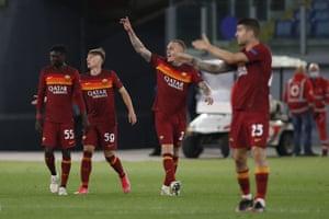 Roma's Nicola Zalewski salutes after scoring the third.