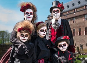 Family dressed as Day of the Dead family at Elfia festival in the Netherlands
