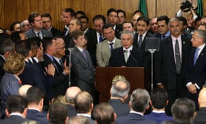 Temer addresses his newly sworn-in ministers.