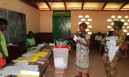 A woman casts her ballot at a polling station in Bangui