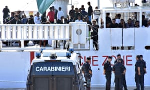 Italian police stand by the Ubaldo Dicotti in Catania, where a group of 177 migrants were prevented from disembarking.