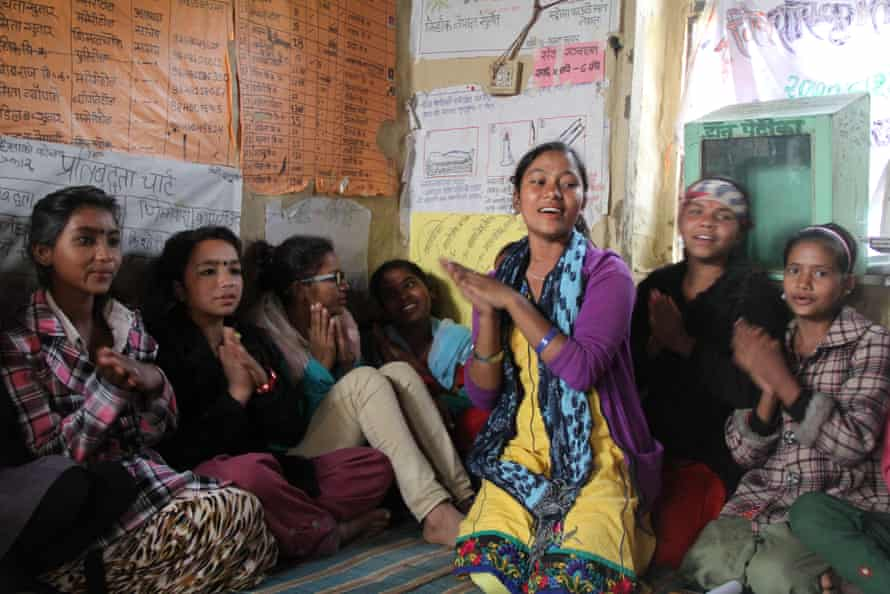 Rachana Sunar discussing child marriage with girls in her village