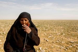 Zahra Buheir, 72, a truffle hunter in the desert in Samawa, Iraq