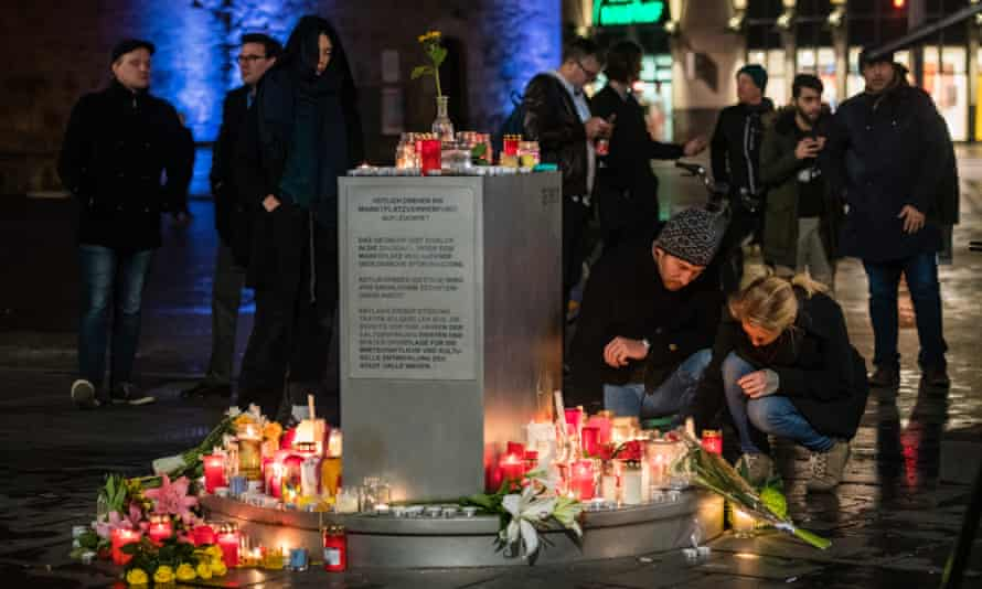 People light candles near the scene of a shooting in Halle, Germany, on 9 October.