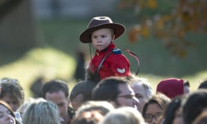 A child wearing a Mountie uniform waits for Prime Minister-designate Justin Trudeau