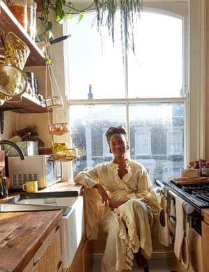 Use leftovers: Africa Daley-Clarke in her kitchen, the surfaces and shelving made from old scaffolding boards.