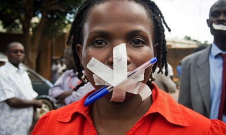 A Ugandan woman takes part in a protest in Kampala after police raided several media outlets in 2013.