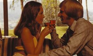 1970s couple drinking wine looking at each other