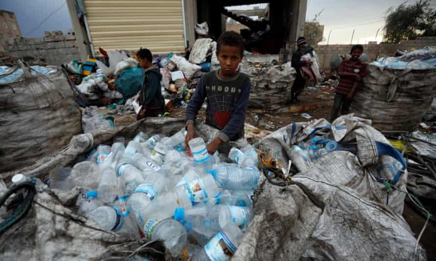 Yemeni children collect recyclables. Britain has drastically cut its humanitarian support for the country's people.