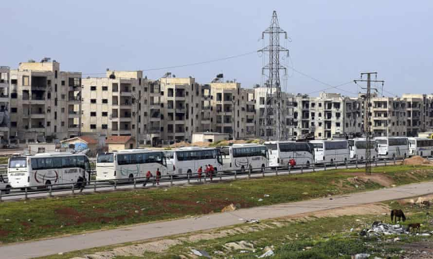 Buses carrying Syrian citizens arrive in Aleppo on Friday after evacuations from the pro-government villages of Foua and Kfarya.