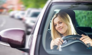 A young woman driving her car