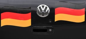 The back of a Volkswagen car that is decorated with stickers featuring German flags, in the small Bavarian village of Eichenau, southern Germany.