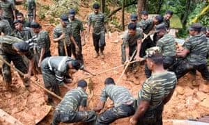 Sri Lankan military rescuers following a landslide in Bulathkohupitiya.