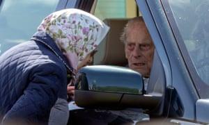The Duke of Edinburgh, 97, talking to the Queen