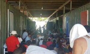 Men occupy the closed Manus Island immigration detention centre
