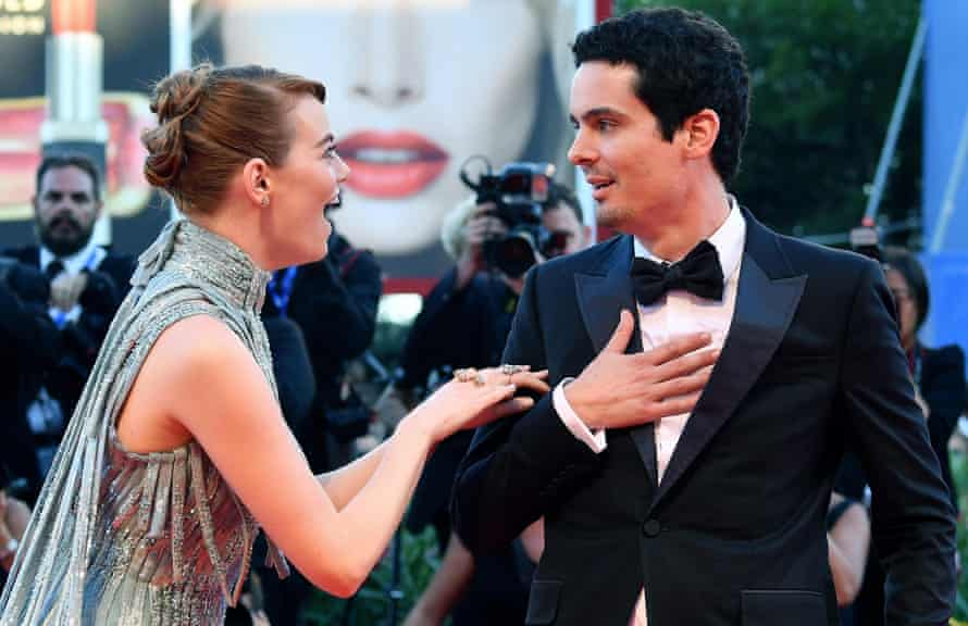 Emma Stone and Damien Chazelle arrive for the opening ceremony and screening of La La Land at the Venice International film festival on 31 August.