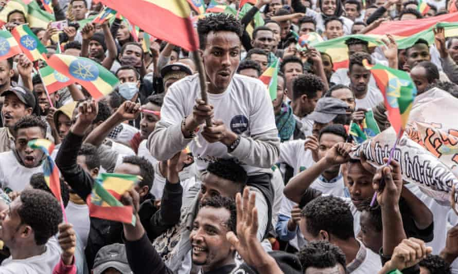 New military recruits in Addis Ababa wave the Ethiopian flag.