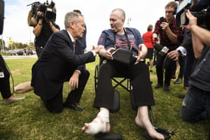 Australian Opposition Leader Bill Shorten speaks to cancer patient Rob Gibbs at the end of a press conference outside Casey Hospital in Berwick