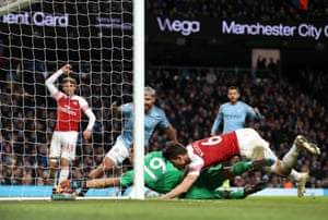 Leno scrambles in a failed bid to stop Aguero scoring his side's third goal of the game