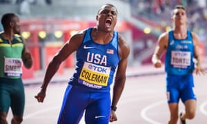 Christian Coleman of the U.S. celebrates winning gold in the men's 100m final.