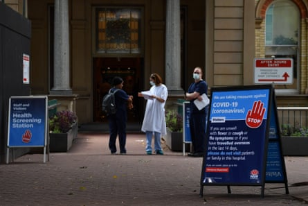 Staff wearing face masks outside the Royal Prince Alfred Hospital in Camperdown, Sydney.