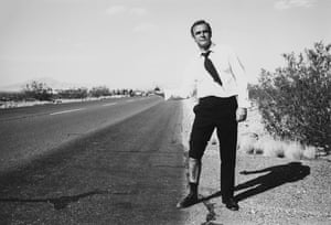 Scottish actor Sean Connery pretends to hitchhike during an off-camera moment during the filming of 'Diamonds Are Forever', 1971.
