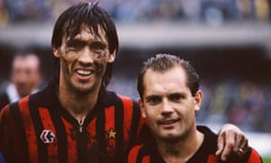 Ray Wilkins with his more muddied Milan team-mate Mark Hateley after a Serie A match against Napoli in 1984.