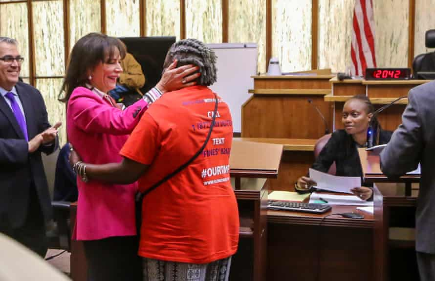 State attorney Katherine Fernandez Rundle hugs Carmen Brown, who had her voting rights restored after the passage of amendment 4.