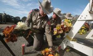 Police move flowers placed at a barricade near the First Baptist church of Sutherland Springs.