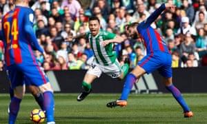 Barcelona's Gerard Pique takes down Ruben Castro.