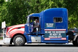 Demonstrators calling for fair broker fees for truck drivers rally outside the White House on 13 May 2020.