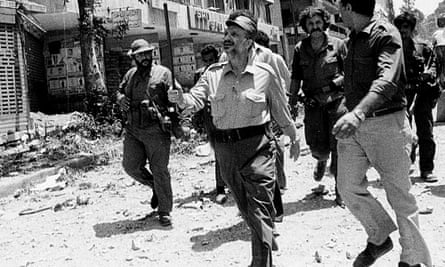 Yasser Arafat pictured in 1982 inspecting bomb damage in Beirut