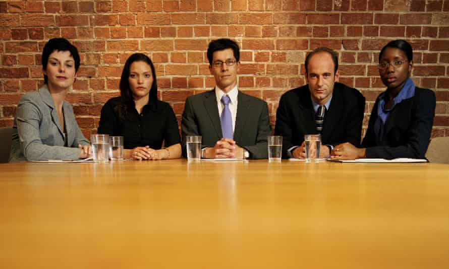 Business people at conference table, portrait. Job interview panel.