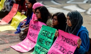 Dhaka University students hold placards as they take part in a rally following the alleged rape of a female student