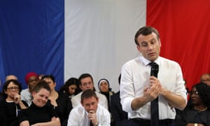 Emmanuel Macron speaks in front of a French flag in Évry-Courcouronnes