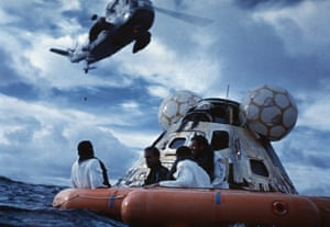 fred haise, jim lovell and jack swigert wait to be picked up by helicopter, 17 april 1970