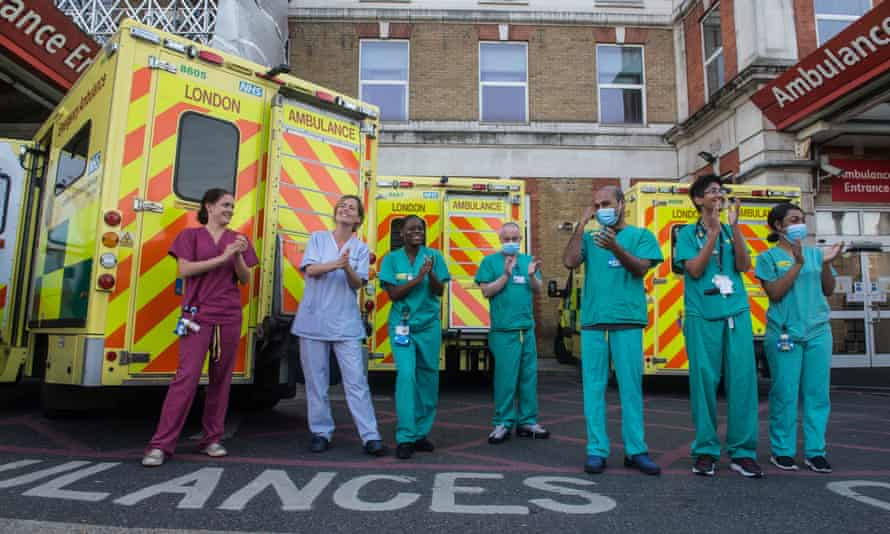 NHS staff in London applaud key workers