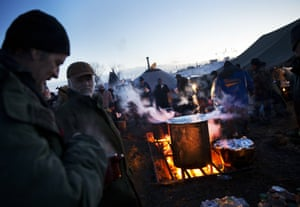 North Dakota, US Veterans line up for dinner at the Oceti Sakowin camp where people have gathered to protest the Dakota Access oil pipeline in Cannon Ball