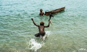 Children swim in water off Savo island, which islanders fear could be leased by a Chinese company.