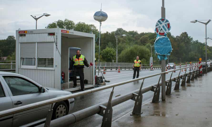 Police control at the border bridge checkpoint in August.