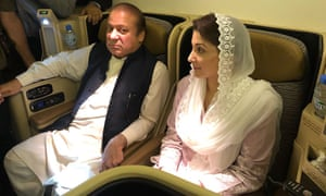 Pakistan's former prime minister Nawaz Sharif and his daughter Maryam Nawaz sit on a plane after landing at the Allama Iqbal International airport in Lahore, Pakistan.