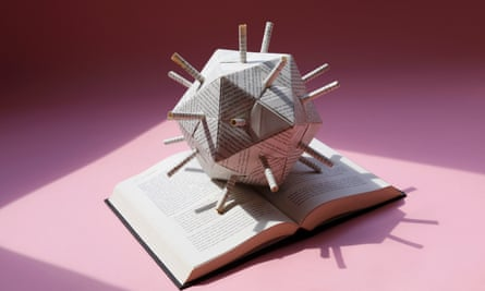 image of an origami globe made from pages of a book on an open book
