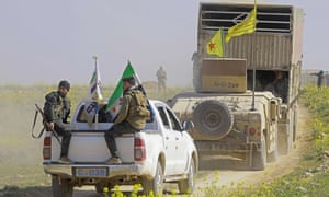 Members of the Kurdish-led Syrian Democratic Forces (SDF) near the Islamic's State's last holdout of Baghouz in northern Syria.