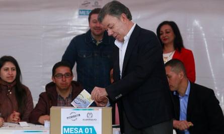 Colombia's President Juan Manuel Santos casts his vote in the referendum.