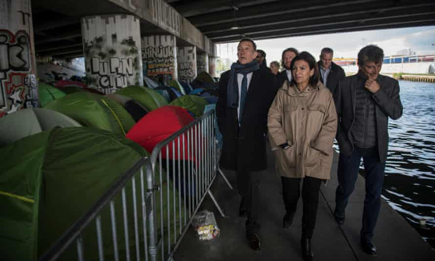 The mayor of Paris Anne Hidalgo visits a makeshift camp in April