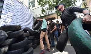 Activists throw tires as they block the entrance of the Inter TV channel in Kiev on the 5 September.